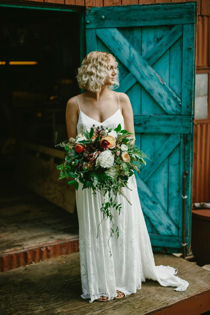 """We really wanted our style to represent who we are as people,"" Danielle says. ""I'm a little boho, and lake life and nature are so important to us, so we decided to go with a lakeside boho theme. Lots of multicolored wildflowers, reclaimed decor, hints of watercolor blues and turquoise and love scattered throughout."""