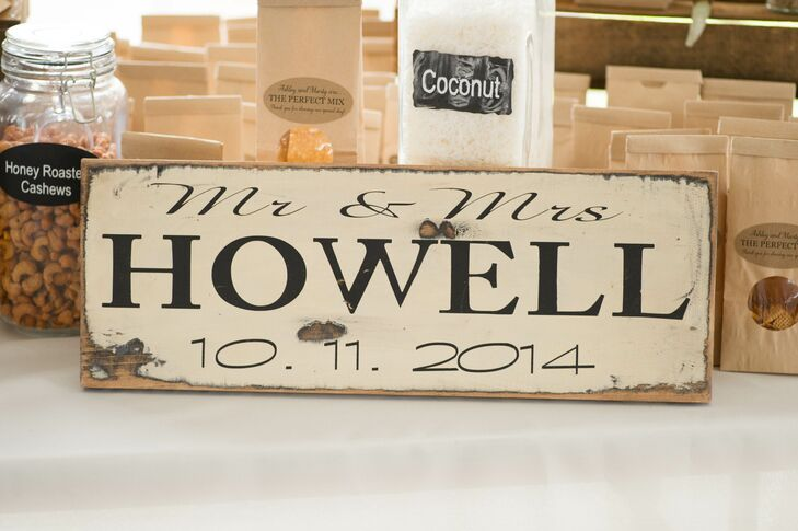Inside the reception tent, a rustic sign that showcased the couple's new name and wedding date helped create atmosphere.