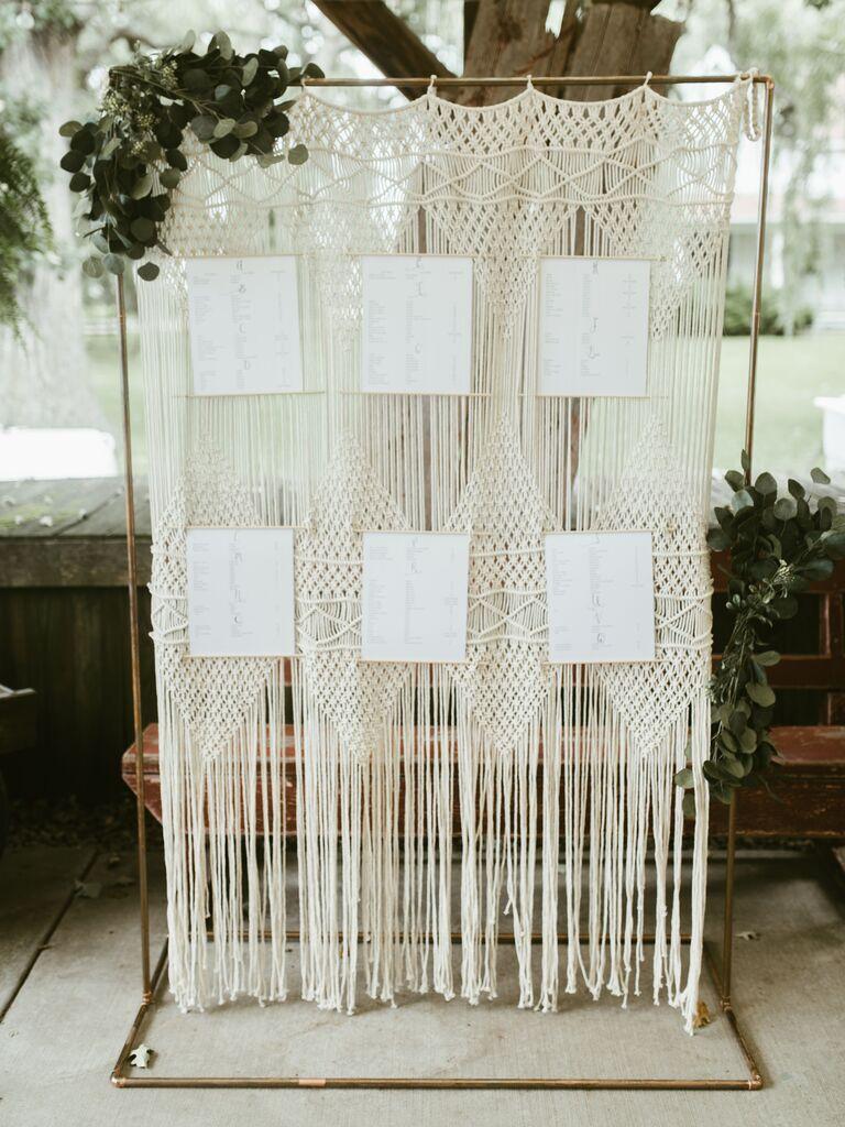 Backyard wedding ideas macrame escort card wall