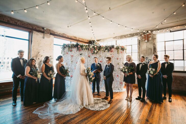 Modern Loft Ceremony with String Lights and Wedding Party
