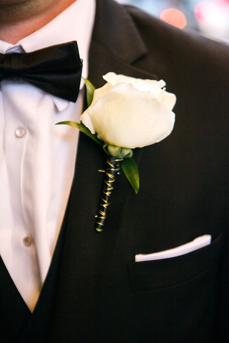 To dress up his classic black Vera Wang suit from Men's Wearhouse, Alex pinned a single ivory rose boutonniere to his lapel—a look that mirrored the blooms in Kristen's bridal bouquet.
