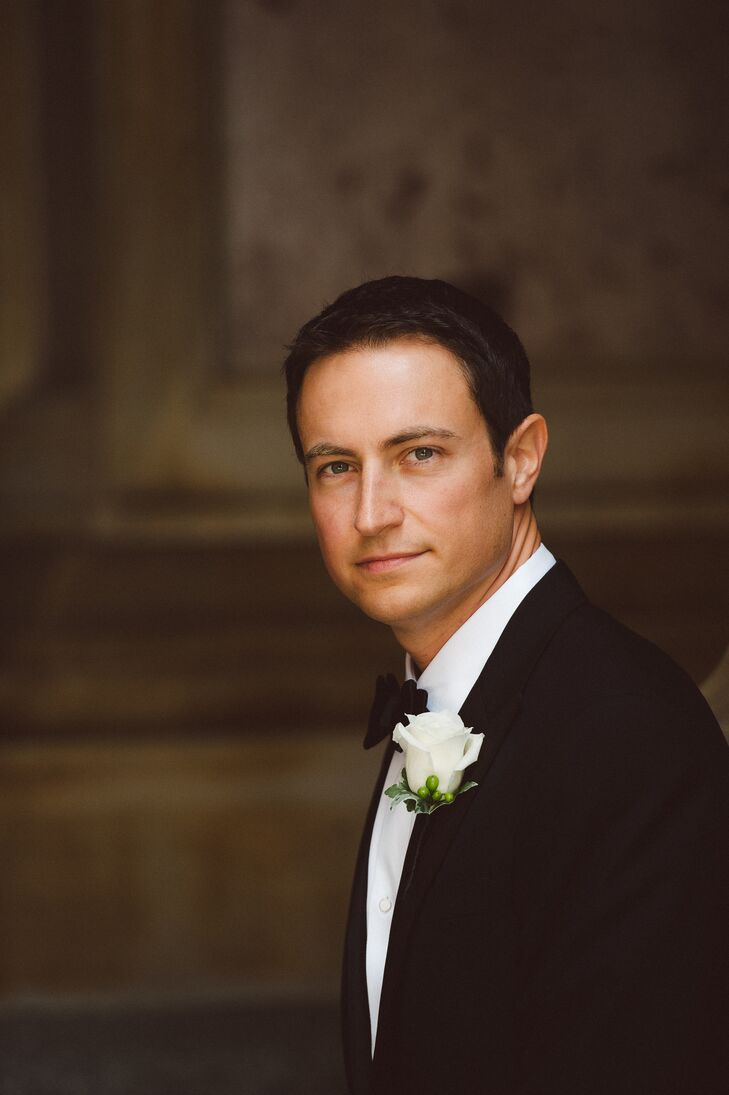 The groom wore a classic Ralph Lauren Black Label tuxedo with a white rose boutonniere.