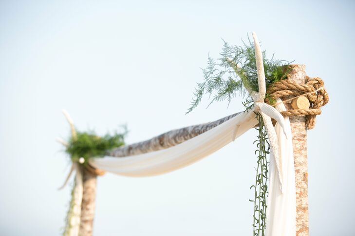 The wedding arch was made from old driftwood tied together with rope. A large dried starfish decorated one corner, highlighting the beach setting.