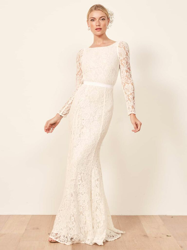 long lace gown with lace sleeves and ribbon tie at the waist