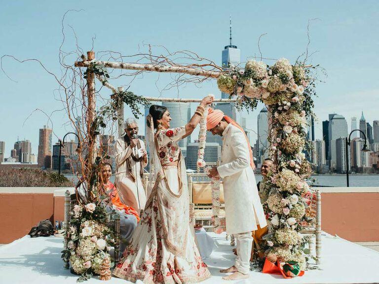 Bride and groom performing Hindu ceremony tradition