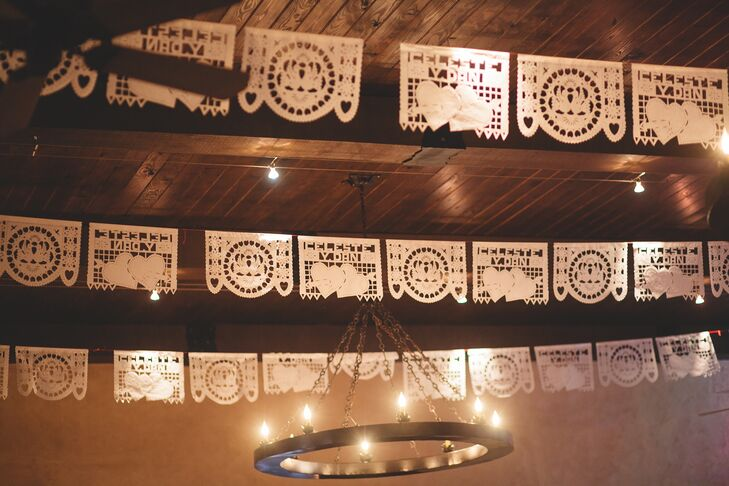 Papel picado, brought in from Mexico City by a relative, make a lovely addition to the decor in the dance hall.