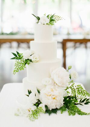 Tiered Fondant Wedding Cake with White Flowers and Leaves