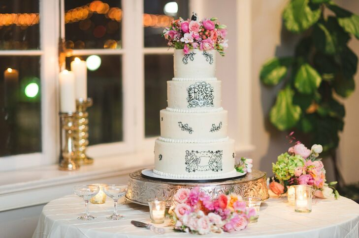 Rebecca and Shawn's wedding cake was accented with hand-drawn monograms, fleurs-de-lis and crocodiles.