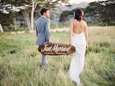 Hawaii couple holding just married sign