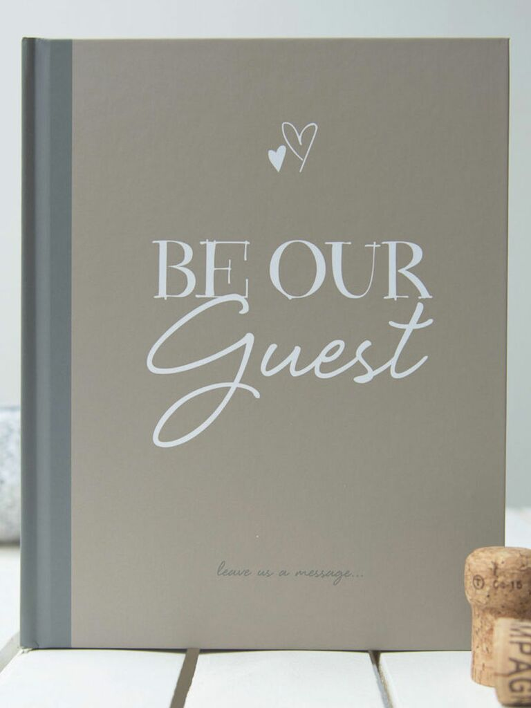 Be Our Guest wedding guest book idea with a hint of 'Beauty and the Beast'