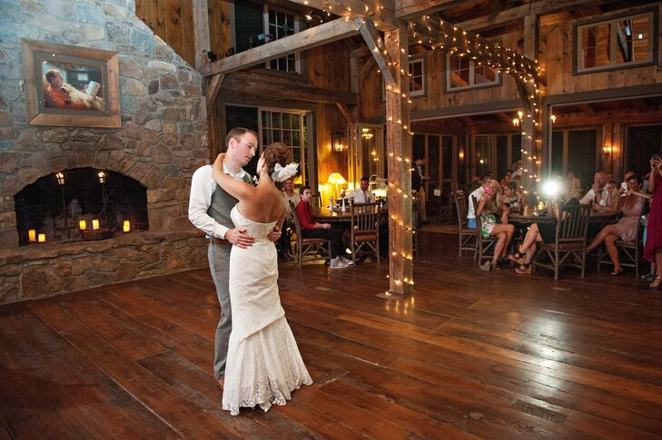 The reception was held in a rustic building at Thorpewood, which featured wood floors, a flagstone fireplace and exposed wood beams illuminated by string lights.