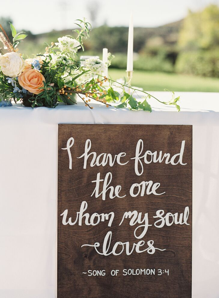 "Handcrafted wooden signs calligraphed in white shared quotes about love. This one reads ""I have found the one whom my soul loves."""