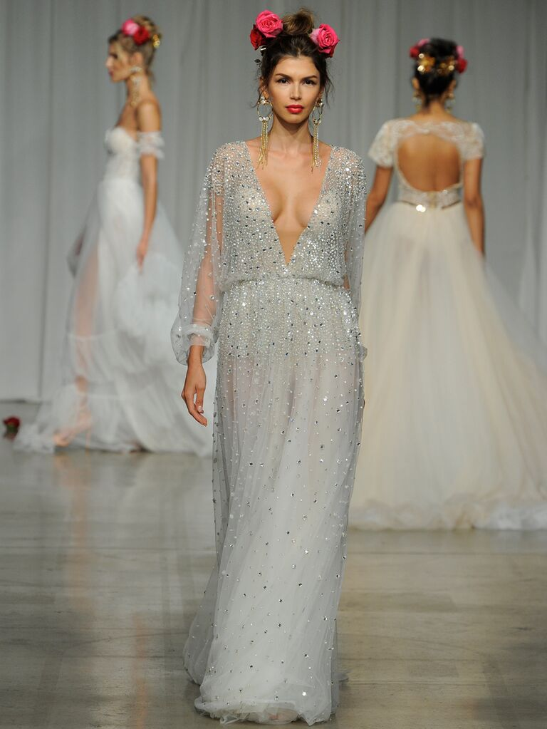Julie Vino Spring 2019 glamorous dove-gray embellished wedding dress with a plunging neckline and sheer long sleeves