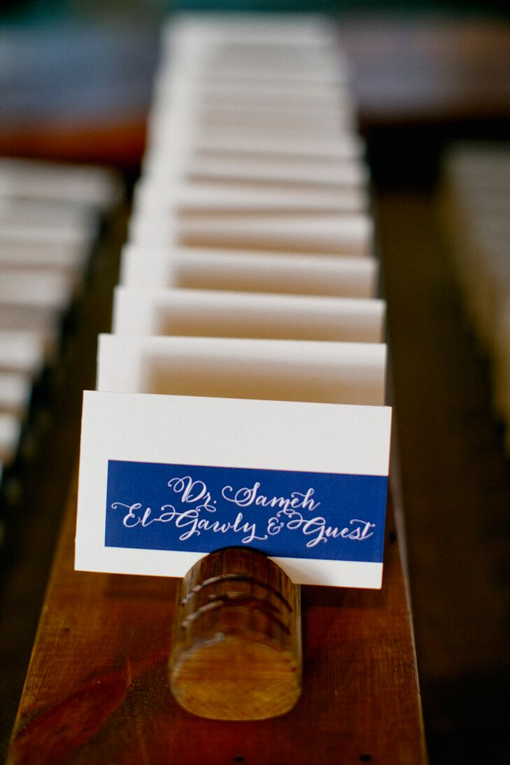 In line with Amanda and Alex's nautical theme, they created cobalt blue escort cards.
