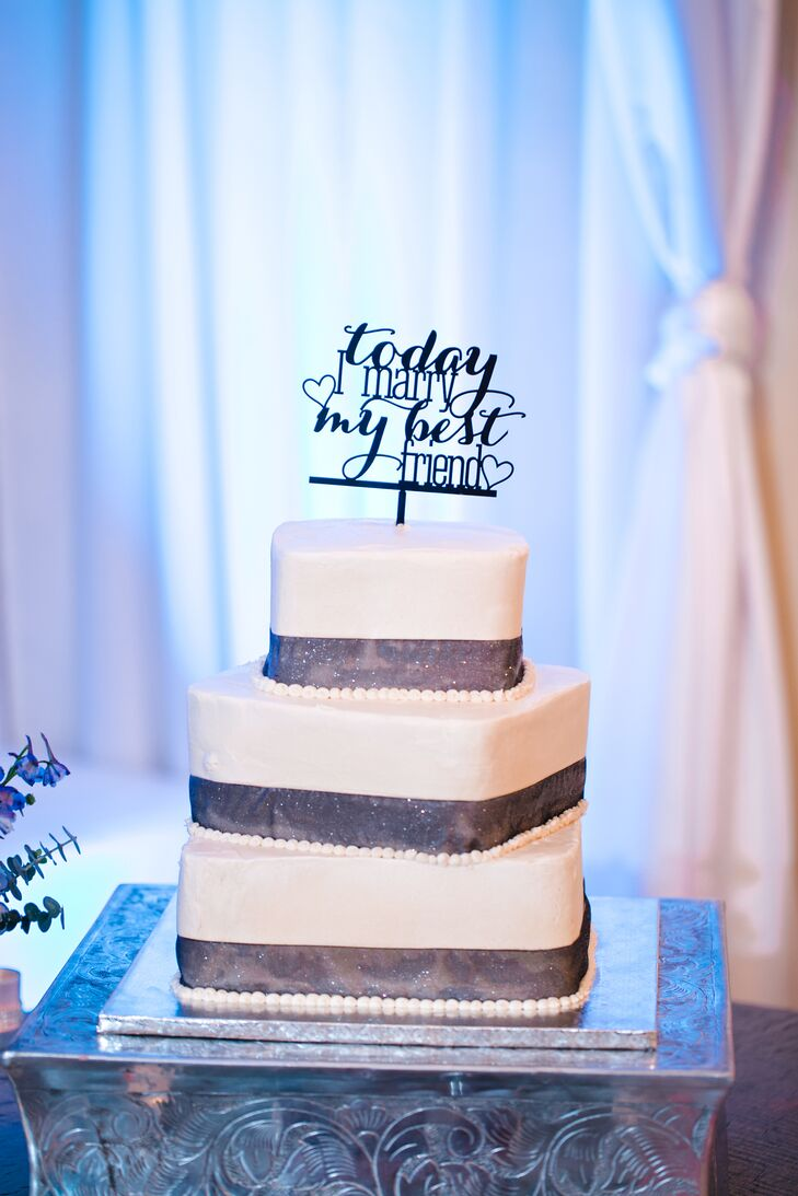 Gloria and Jill opted for their favorite vegan bakery, Nami, to make their wedding cake. The three-tier square wedding cake, accented with glittery black ribbon, alternated carrot cake with vida dolce cake with cream cheese frosting. The couple loved it!