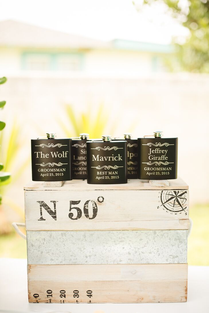 The groomsmen received black flasks as a gift form Veronica and Tim, customized with their individual names and the wedding day date at the bottom.