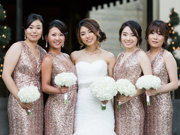 Bride with bridal party in rose gold sequin bridesmaid dresses