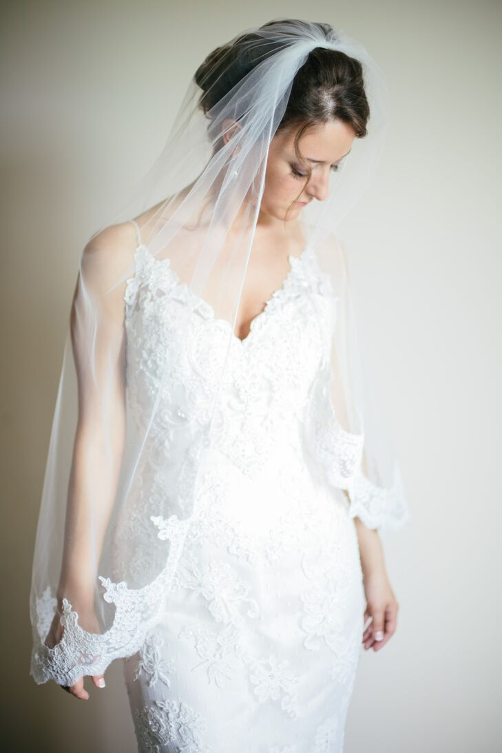 Nicole, a lover of all things romantic and lace, opted for a Casablanca Bridal v-neck lace overlay gown. Her lace edged fingertip veil sat atop her perfectly coiffed bridal updo.
