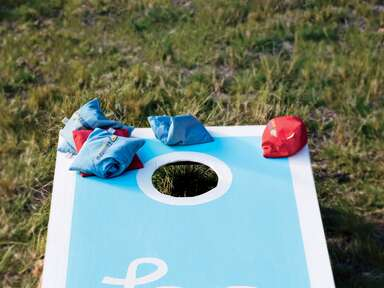blue and white DIY cornhole game
