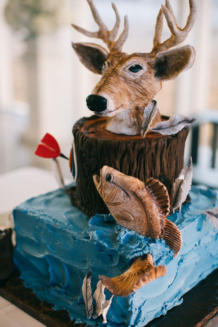 The groom's cake was inspired by Carson's love of hunting and the outdoors, complete with a deer and fish. The inside was made of white and chocolate cakes.