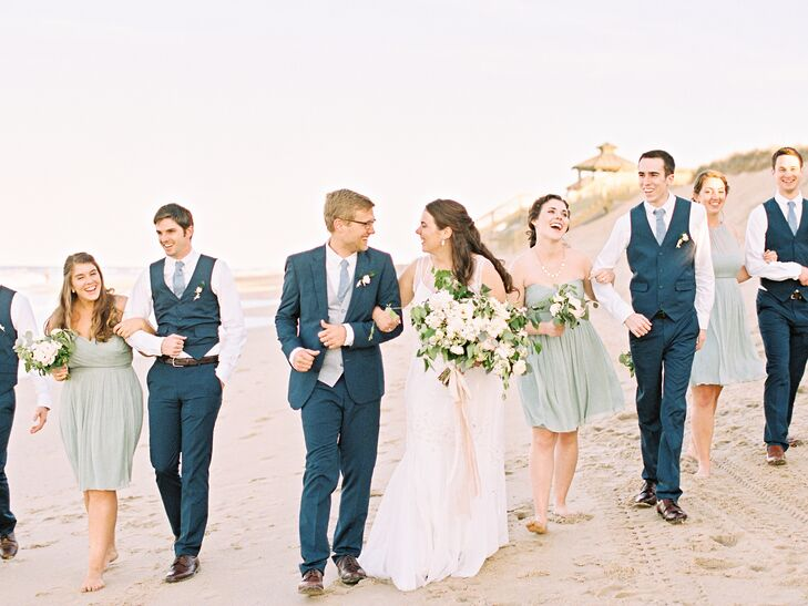 Taylor's five bridesmaids all wore dusty shale dresses in whatever style they wanted from J.Crew. The groomsmen wore blue pants from ASOS with matching blue vests and no jacket for a casual look that still respected the event's importance. The rest of their attire—white shirts, faded chambray ties and turquoise sailboat socks—were all from J.Crew Factory.