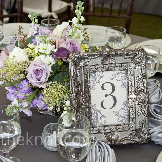 Lush arrangements of antique lavender roses and Queen Anne's lace were placed in different silver bowls for a vintage look.
