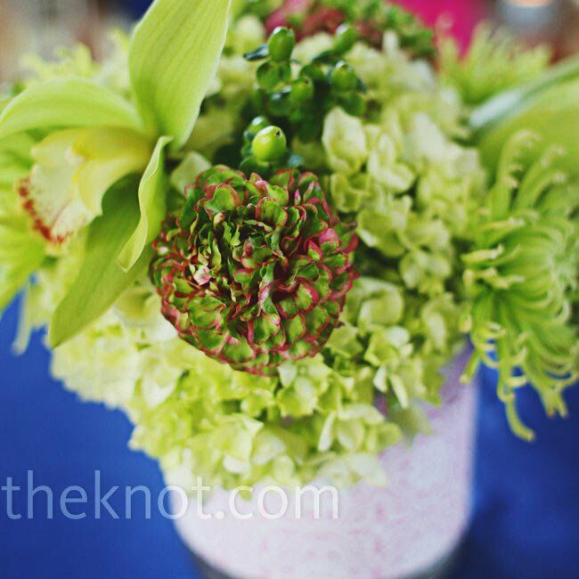 The all-green flowers looked even brighter and full of texture in paper-wrapped vases.