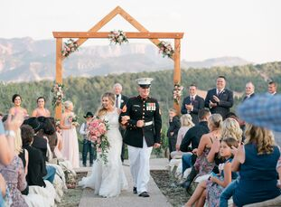 From the custom wedding arch to the rustic wooden place settings and ice cream bar, Traci Greninger and Travis Schlotterbeck's mountaintop wedding was