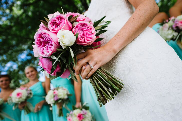 Kelsey's bridal bouquet was a mix of large, bright pink garden roses and white roses.