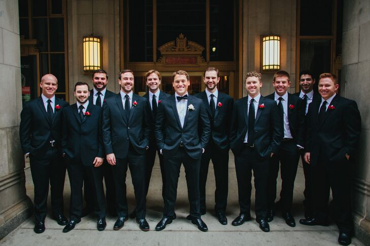 Each groomsman paired a classic black tuxedo with red ranunculus and dusty miller boutonnieres. Dave set himself apart by completing his look with a single white ranunculus on his lapel.