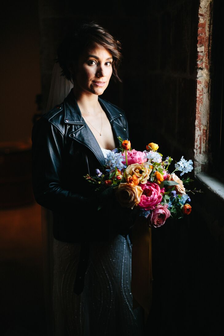 """With Adam donning a burgundy suit and the bridal party clad in blue, Liz feared that the aesthetic would take a slightly patriotic turn. """"We asked our florist to use a bright and colorful palette, in keeping with the whimsical theme of our wedding,"""" Liz says. """"She nailed it! The yellow ribbons she used in the bouquets and boutonnieres were a perfect contrast to the reds and blues."""""""