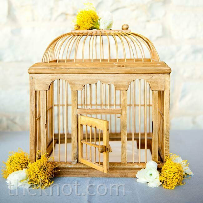 Alexis found this wooden birdcage to display at the welcome table. Guests dropped cards inside.