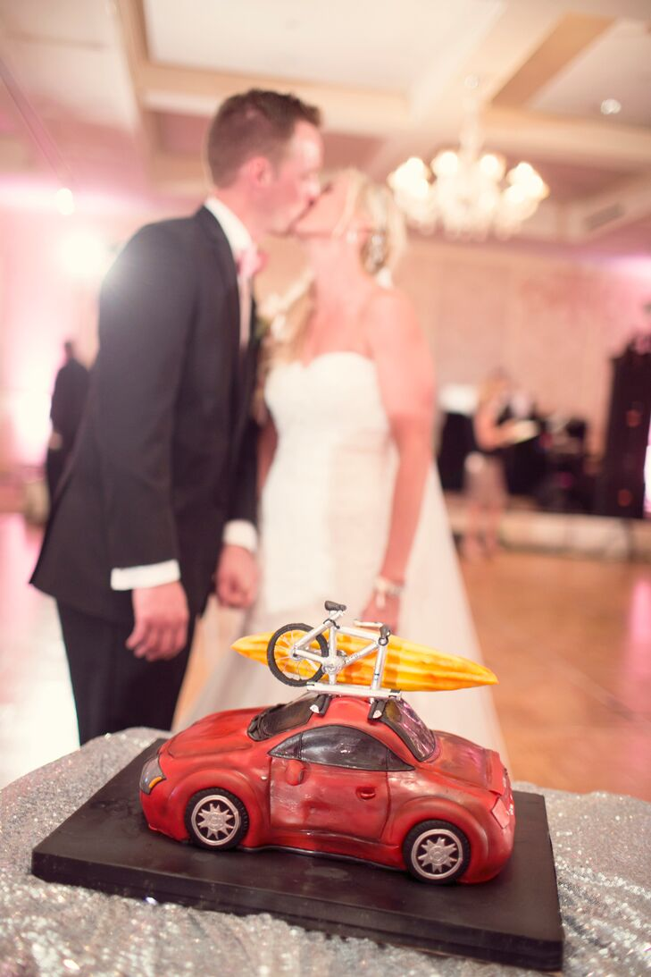 """At the last minute, Katie switched cake vendors without Scott knowing it so that she could surprise him with a custom-made groom's cake made to look like his car, """"the other love of his life,"""" she says. This also meant changing the wedding cake design, so when Scott saw it, he panicked thinking Katie would freak out that it was different. """"Little did he know that there was a huge surprise waiting for him!"""" she says."""