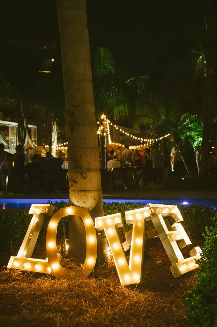 For a fun touch, the couple used marquee lights to spell out LOVE.