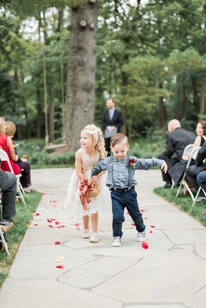 Flower Girl and Ring Bearer Walking Down Outdoor Aisle with Rose Petals