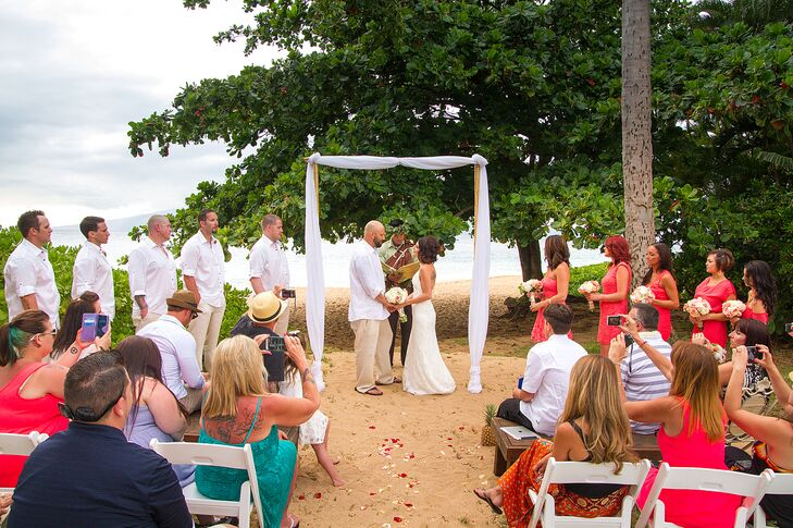 The wedding arch was built with bamboo stakes and wrapped with white linens.