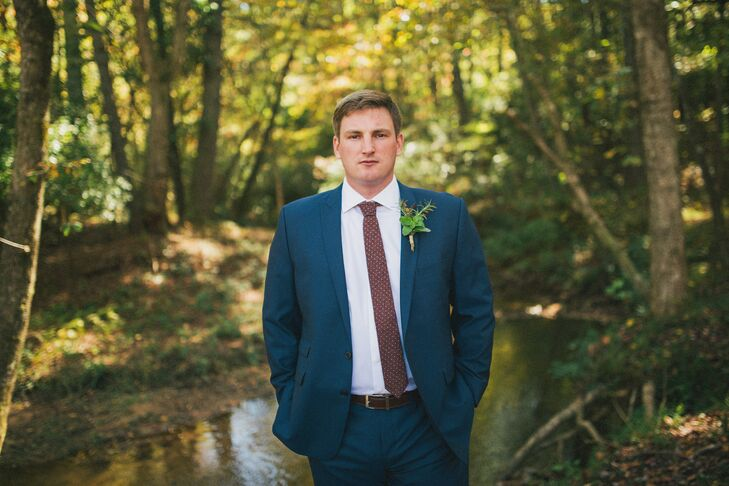 Dan's favorite color is blue, so he chose his own suit, a Calvin Klein number from Men's Wearhouse. He also wore a vintage cranberry J.Crew tie, given to him by the bride.