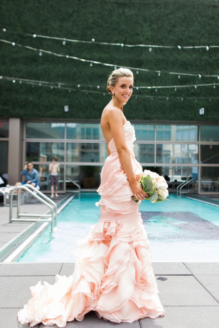 """Cecilia looked to Project Runway winner Leanne Marshall for help creating her custom-made, strapless pink gown. """"I always knew I wanted my wedding dress to be unique,"""" Cecilia says."""