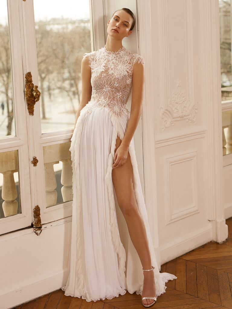 Dana Harel Spring 2020 Bridal Collection wedding dress with high leg slit and embroidered high-neck bodice