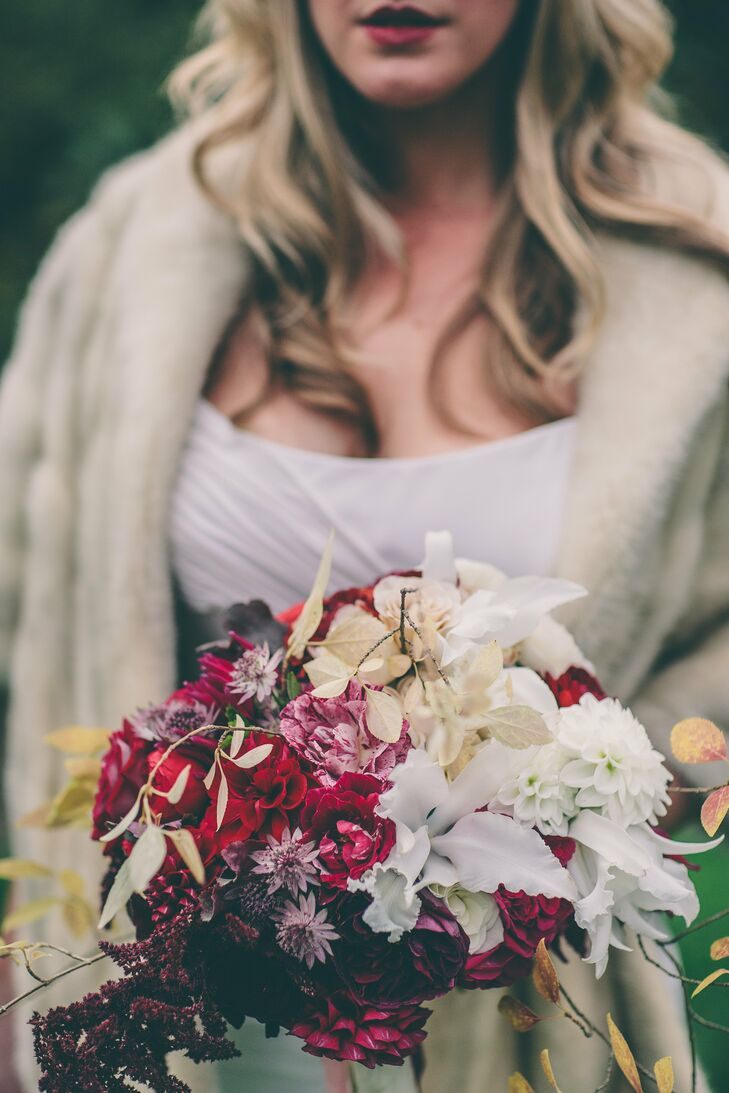 Anja's bouquet was filled with a mix of textured blooms and leaves in a scarlet, cream and chocolate color palette.