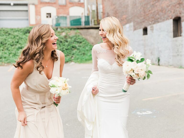 maid of honor and bride laughing