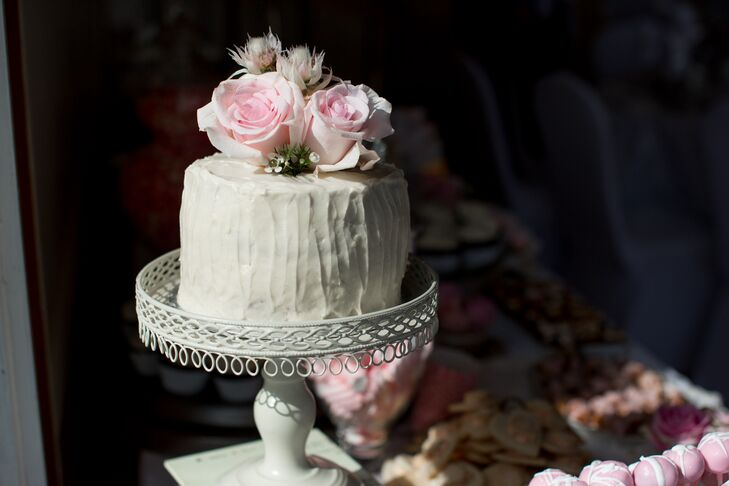 Sarah made the small, elegant wedding cake, which was decorated with fresh pink roses.