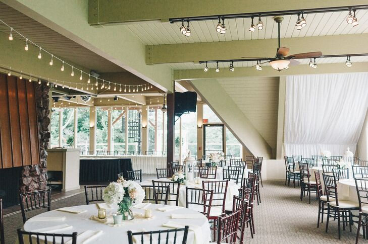 Crisp white linens, dark brown chiavari chairs and soft floral arrangements added a romantic touch to the simple modern architecture of the reception room.