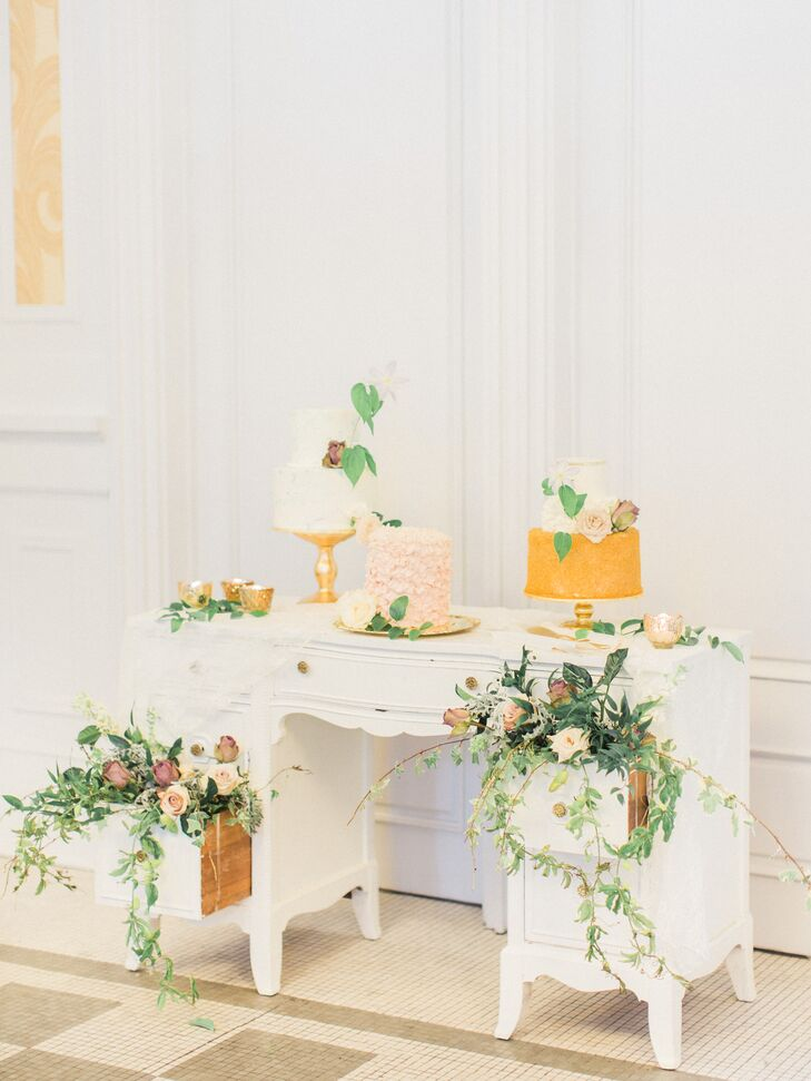 Different Wedding Cakes Atop Vintage Desk