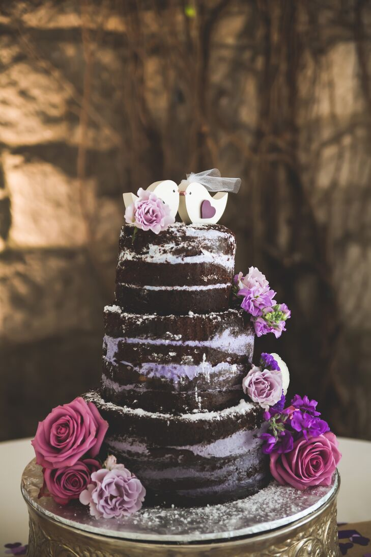 Layers of purple buttercream filled the chocolate name cake and created an ombre effect, darling with each descending tier.