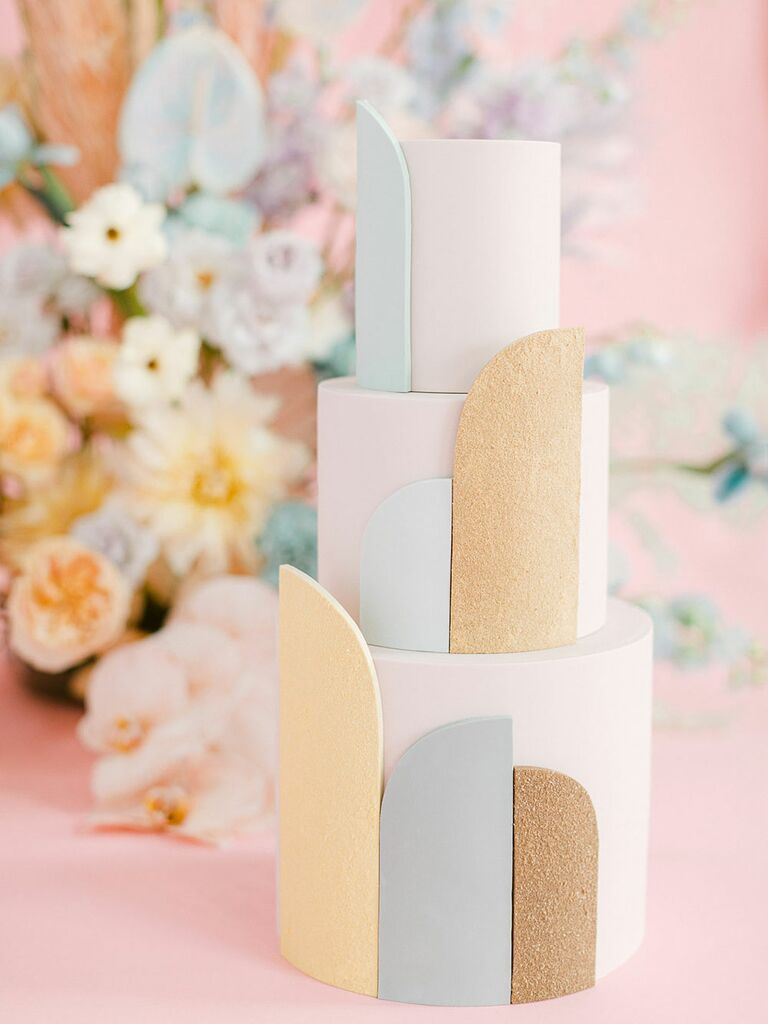 Three tier white bridal shower cake with gold glitter and pastel accents