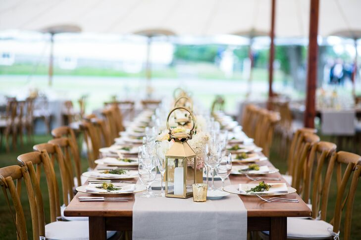 """""""The decor was intended to be simple, elegant and romantic,"""" Caitlin says. """"We wanted the colors to be soft and beautiful. I really wanted the wedding to glow with the lights and flowers."""" Caitlin and Mike decorated the open tent with rustic family-style tables, gold lanterns and low floral centerpieces."""