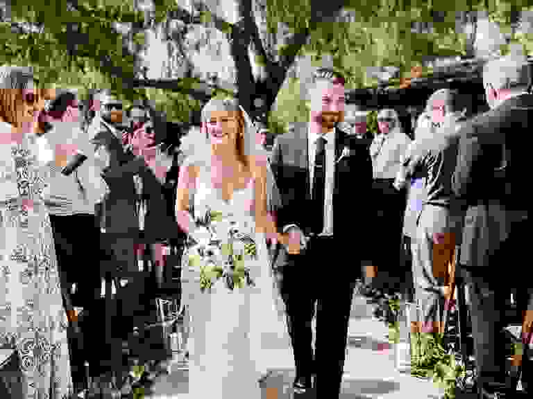Bride and groom at summer wedding ceremony