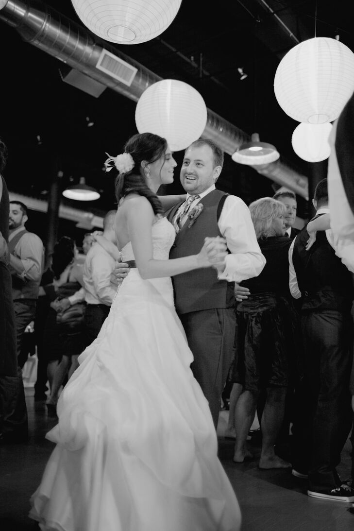 The couple took a spin around the dance floor to Love is All Around by REM.