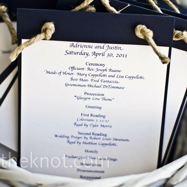 The crisp navy and white programs were tied with knotted hemp and hung from the ceremony chairs.